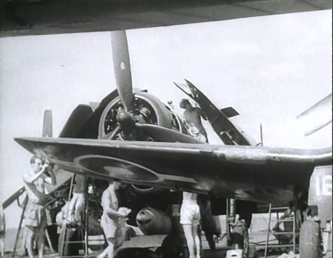 Mainteanance crew examine an Avenger aboard HMS FORMIDABLE