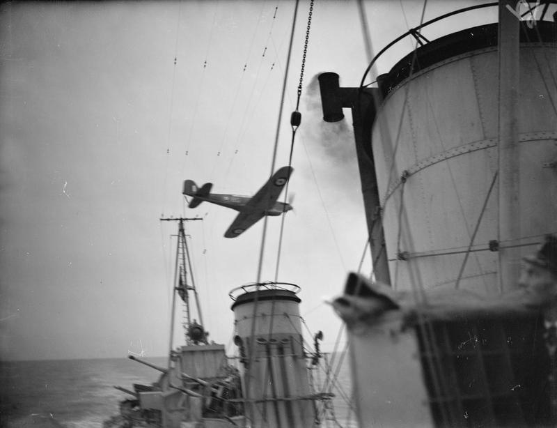 A Fairey Fulmar practising dive bombing on HMS BEDOUIN at sea.