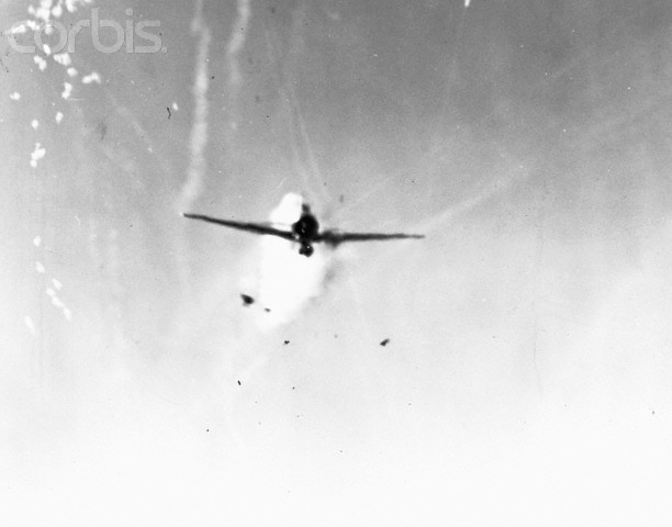 Japanese plane (Zeke of Oscar) in Lingayen Gulf, diving on the USS New Mexico (BB 40) from astern. Plane struck the port side of the bridge three seconds later. January 6, 1945