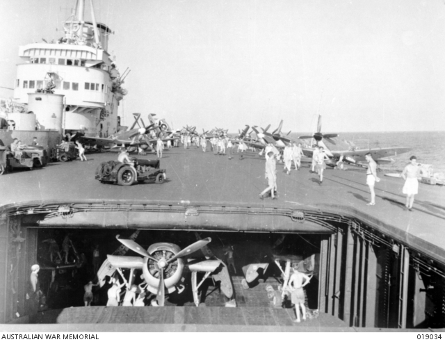 HMS Implacable was one of the aircraft carriers of the British Pacific Fleet operating against Japan. Here an Avenger is struck below into the upper hangar.