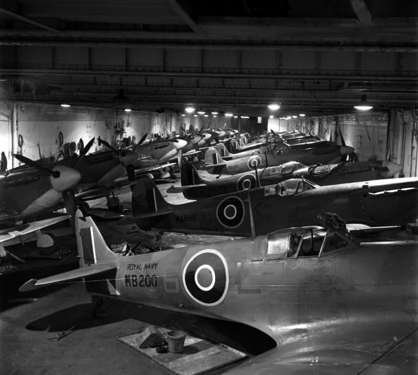 Non-folding Seafire IBs and IICs stowed within HMS INDOMITABLE's hangar in 1943.