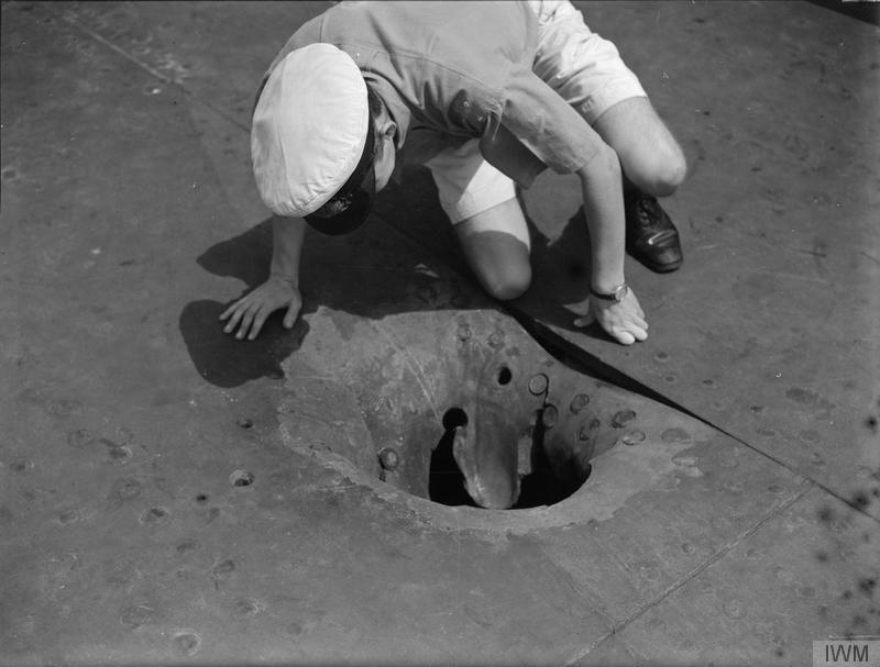 The 14in penetration hole near Indomitable's forward lift.
