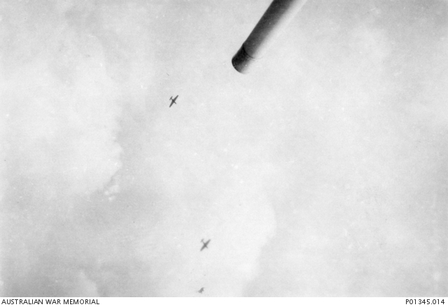 Stukas enter their dives above the guns of HMAS Perth.