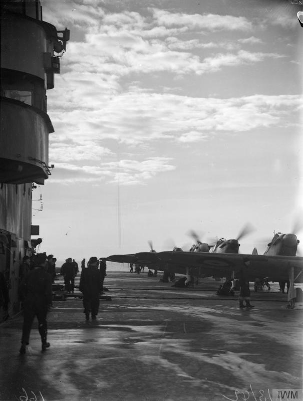 Fulmars exercise abouard HMS VICTORIOUS in March, 1942.