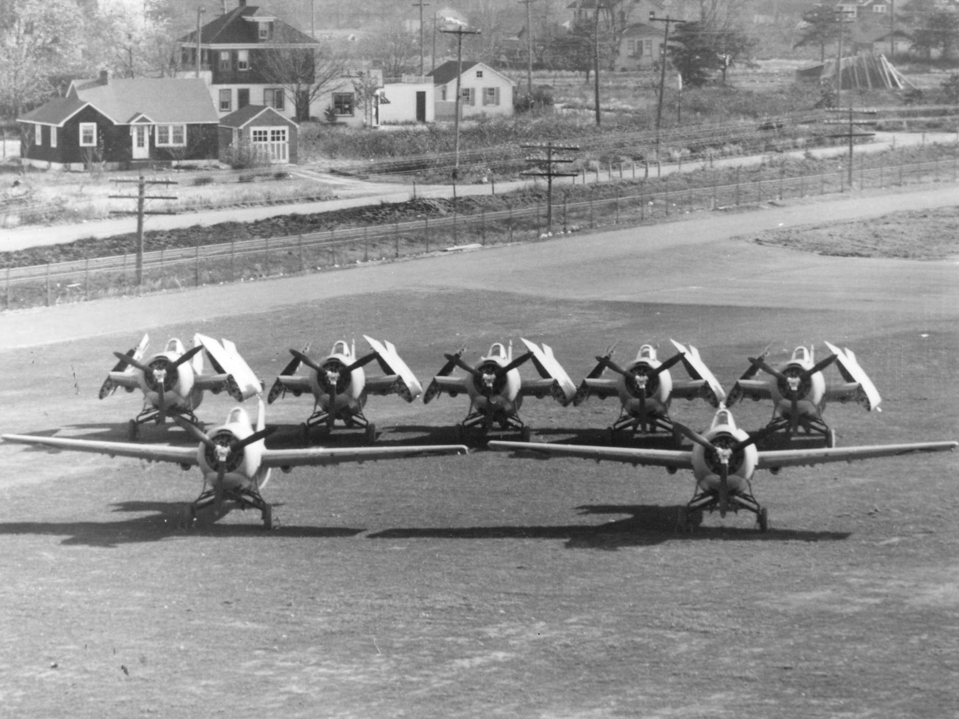 Space savings ... Five folded Martlets compared with two unfolded Wildcats. For this, and the ability to be stowed below on the narrow armoured carrier lifts, the FAA was willing to delay its order of the F4F.