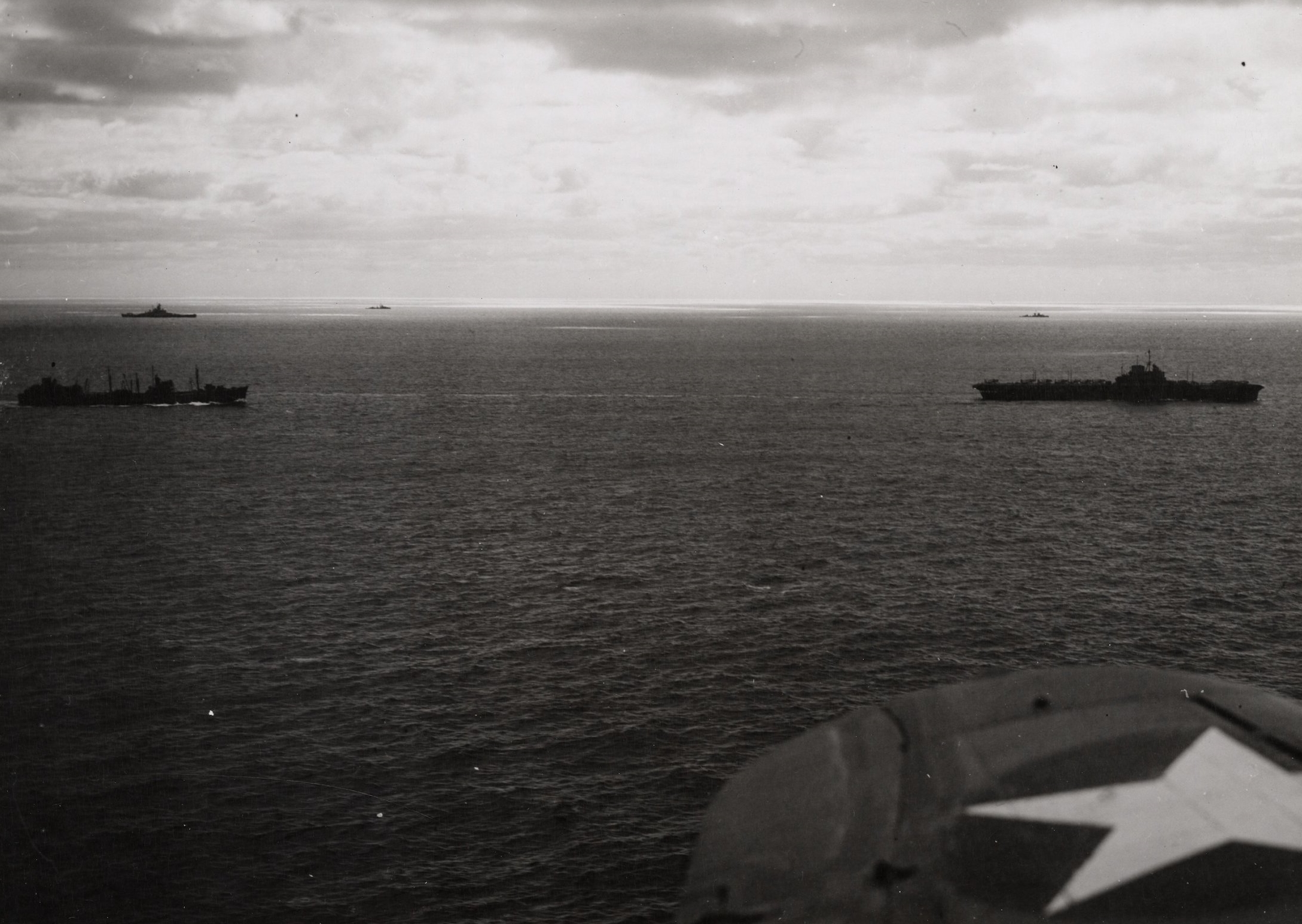 HMS VICTORIOUS at sea with the battleships, escort and supply ships of Task Force 14