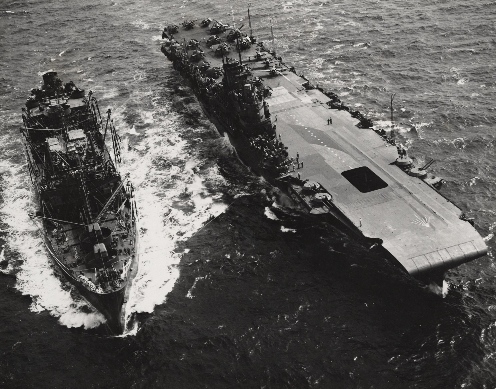 USS CIMARRON refuels USS ROBIN (HMS VICTORIOUS) on July 12, 1943.