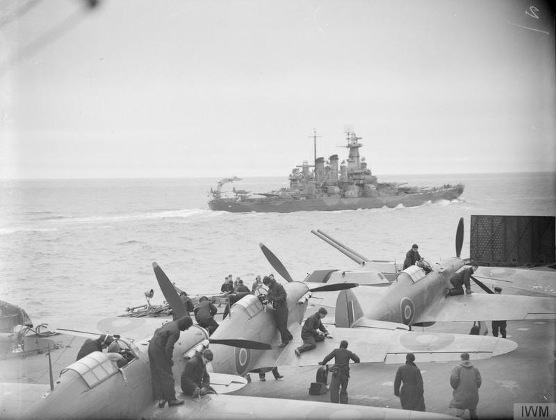 USS WASHINGTON as seen over the Sea Hurricanes aboard HMS VICTORIOUS in July 1942.