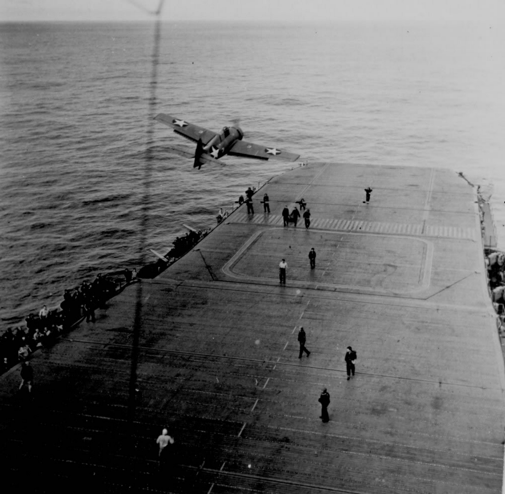 A Wildcat 'beats up' the flight deck of the training carrier USS CHARGER.