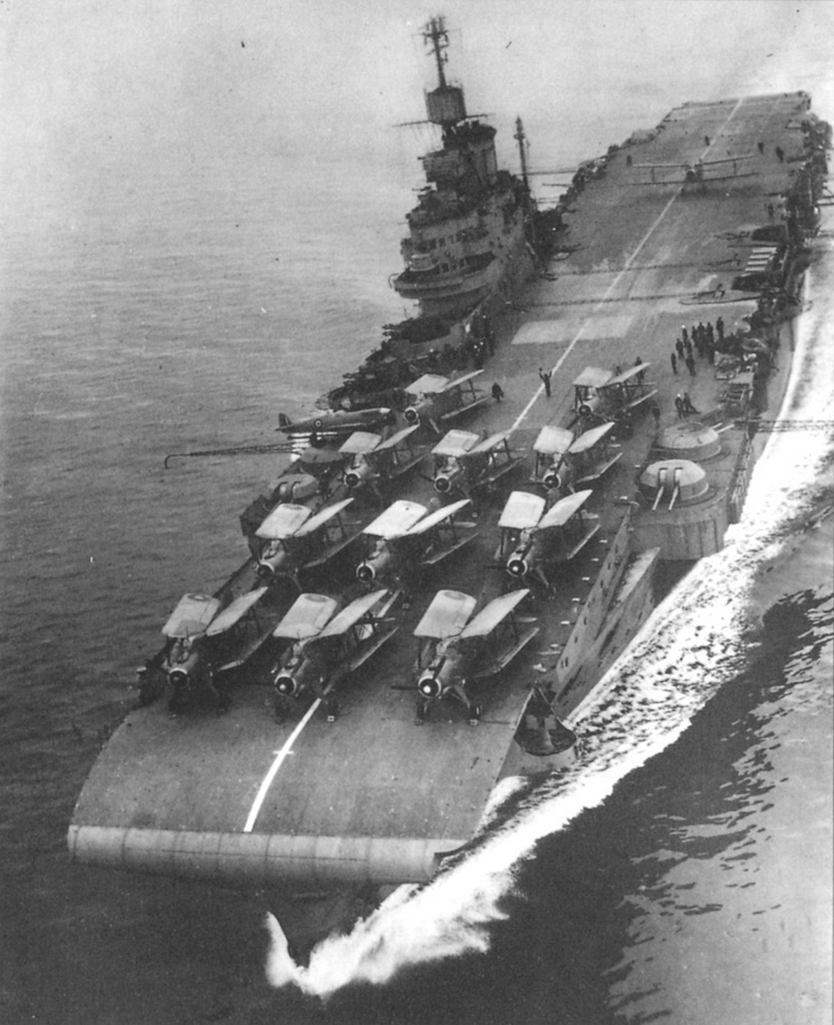 HMS INDOMITABLE, pictured in early 1943. Note the Seafire on the outrigger just behind S2 4.5in and in front of S1 Pom Pom.