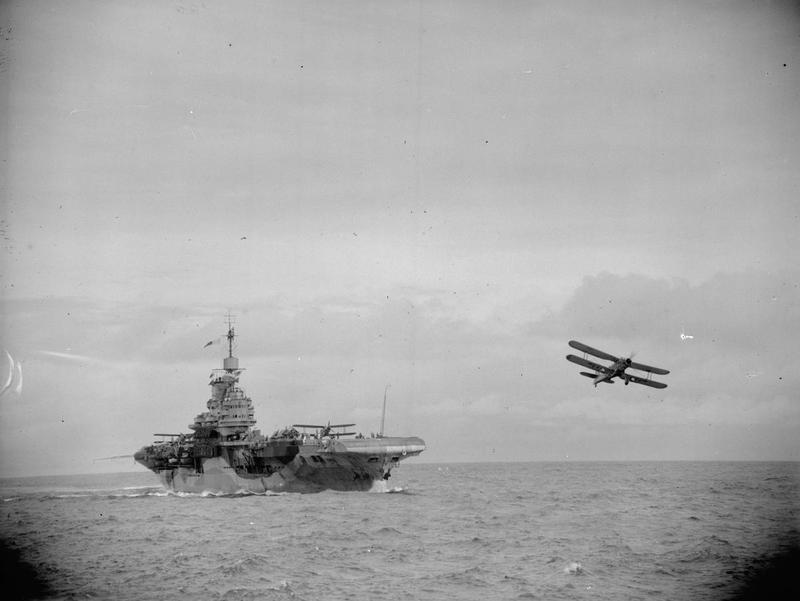 HMS FORMIDABLE flies off Albacores in the Indian Ocean, as seen from HMS WARSPITE.