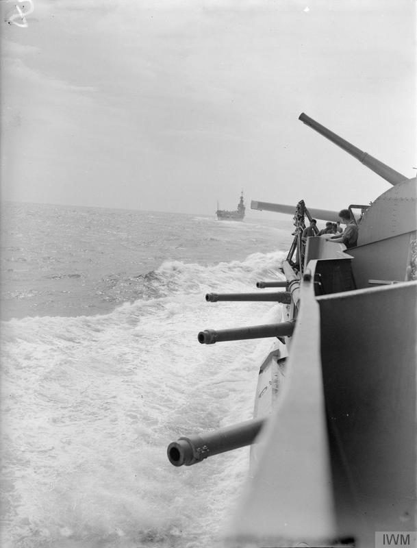 The antique 6 inch guns of HMS WARSPITE's secondary battery are juxtaposed with the 4 inch High Angle mount fitted during her 1930s refit. In the distance is HMS FORMIDABLE.