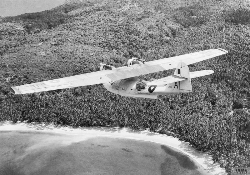 Catalina Mark IVB, JX431 'A', of No. 205 Squadron RAF, flying along the coast near the unit's base at Koggala, Ceylon.