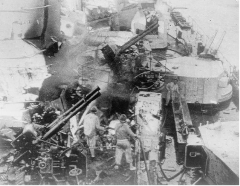 Damage to the Italian battleship GIULIO CESARE sustained from a 15-inch shell hit from HMS WARSPITE off Calabria.
