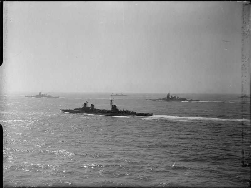 The cruiser EMANUELE FILIBERTO DUCA D'AOSTA (foreground) steaming with (left to right) the battleship VITTORIO VENETO, the cruiser EUGENIO DE SAVOIA, and the battleship LITTORIO