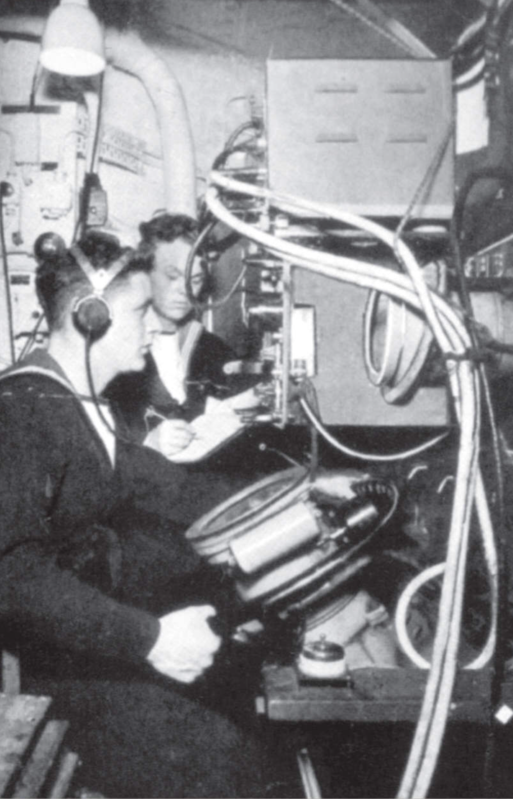 Operators with early examples of radar sets aboard an RN warship.