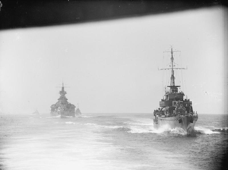 HMS VALIANT, with her destroyer escort passing through the Sicilian Narrows.
