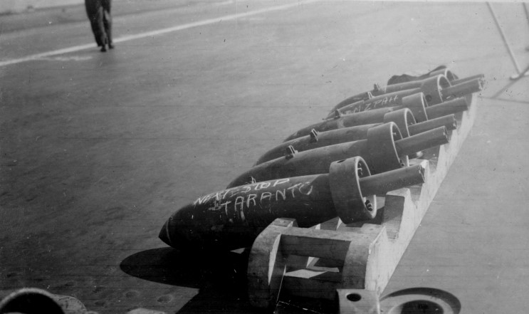 No return address... 250lbs bombs arrayed on HMS ILLUSTRIOUS' dek during the 'bombing-up' process shortly before the attack on Taranto.