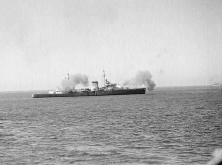 HMS ORION shooting her main armament.