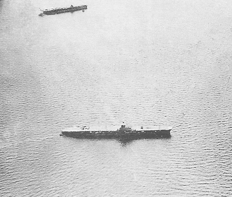 The Japanese armoured flight deck aircraft carrier Taiho, pictured between May 15-16, 1944, at Tawitawi, Borneo. A Shokaku class carrier is in the background.