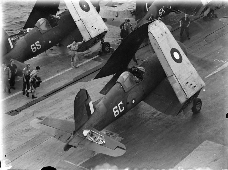 The Chance-Vought Corsair fighter flown by Sub Lieut John R Baker, RCNVR, of Toronto, with its wings folded. On the elevator can be seen a large hole made by a Japanese anti aircraft shell.