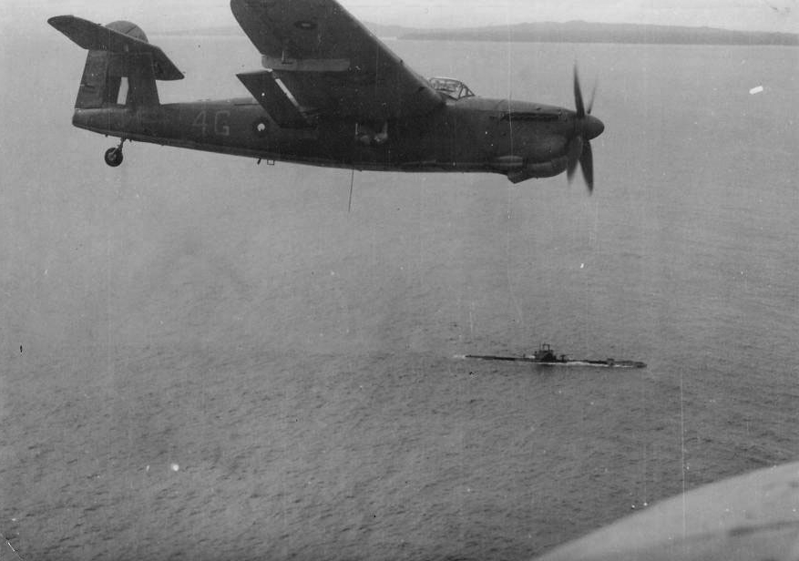 A Barracuda in Eastern Fleet markings flies over an ASR submarine.