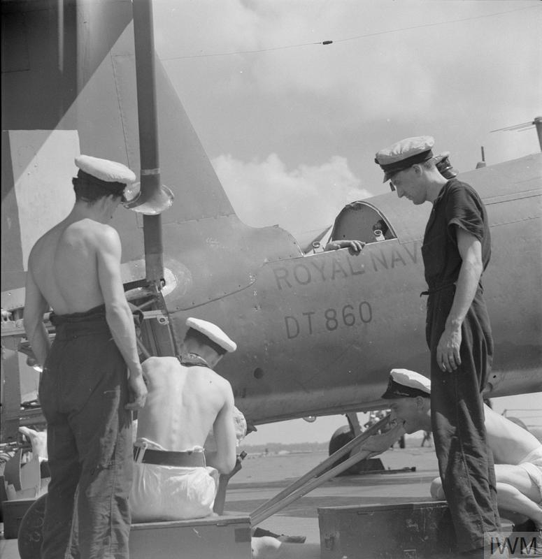 A repair squad at work aboard HMS UNICORN at Trincomalee in February 1944.