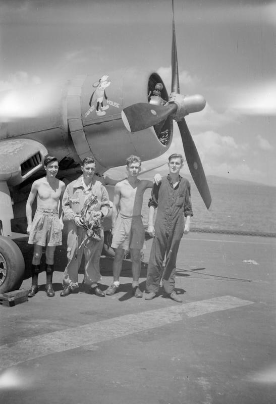 'Super Mouse' with its pilot Lieut (A) J H Clarke, RNZNVR, Otorohanga, NZ, and Maintenance Crew. Left to right: LAMA James McKenzie, Edinburgh; Petty Officer RM, Wilfred Price, Brecon, Wales; LAME A S Townsend, Hope, Derbyshire. Pictured in April 1945 aboard HMS ILLUSTRIOUS.
