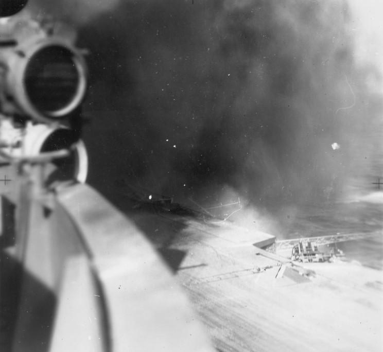 Smoke rises after a bomb bursts on HMS Illustrious' aft deck.