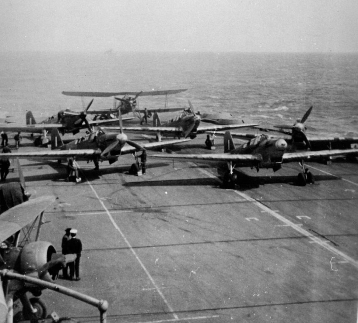 Fulmars of 806 Squadron and a Swordfish ranged on HMS Illustrious in November 1940. Note the two Sea Gladiators of 813 Fighter Flight tucked away aft of the island. They were transferred from HMS Eagle for the Taranto strike to increase the number of fighters on board.