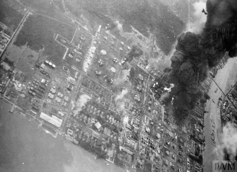 The nerve centre of the Japanese Oil refinery at Songai, Gerong, near Palembang, Sumatra, blazing fiercely after the Grumman Avenger attack flown off carriers of the Eastern Fleet.