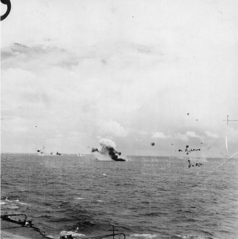 Click on this photo, taken moments before the one below, for an enlarge view of the Seafire's attack on a Japanese 'Sally' bomber (labeled on right side of image).