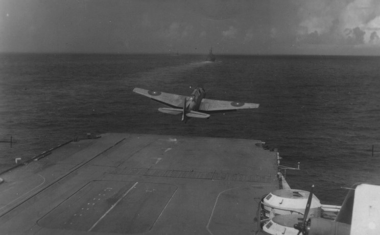An Avenger takes off from what appears to be HMS VICTORIOUS. The roundels on the wings have obviously been hastily painted-over to make them conform to Eastern Fleet standards.