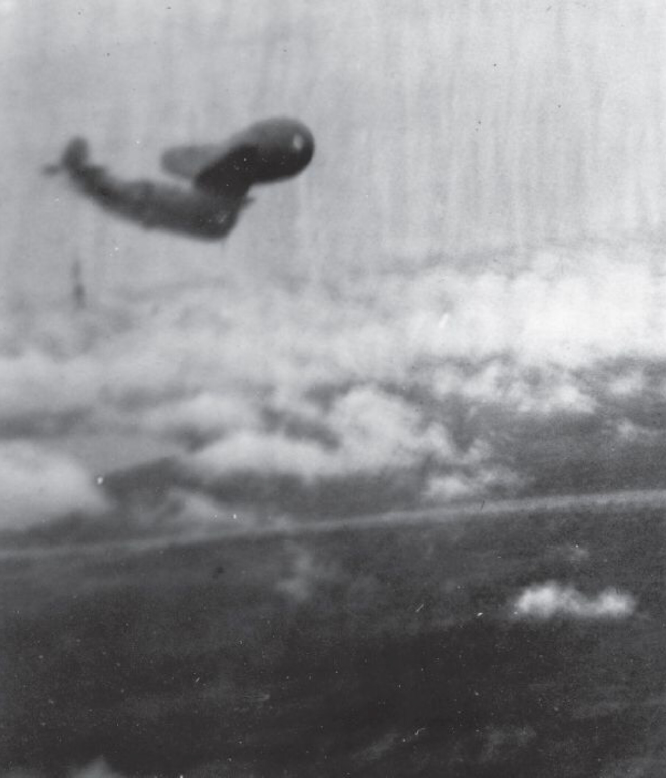 This picture, taken by the observer of an FAA Avenger as it dove on Soengi Gerong, shows another Avenger at the moment it struck a balloon cable.