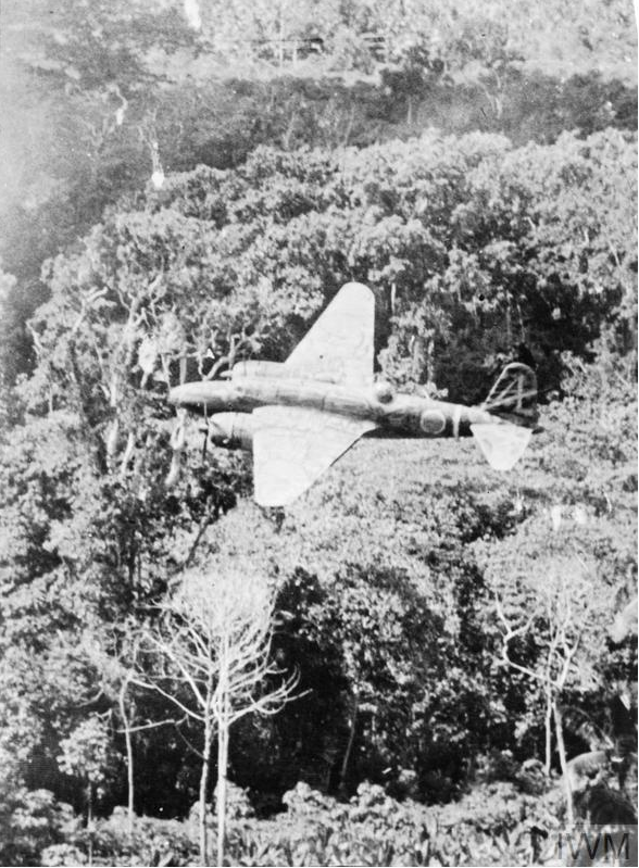A Ki-21 Sally is pictured flying over dense jungle.
