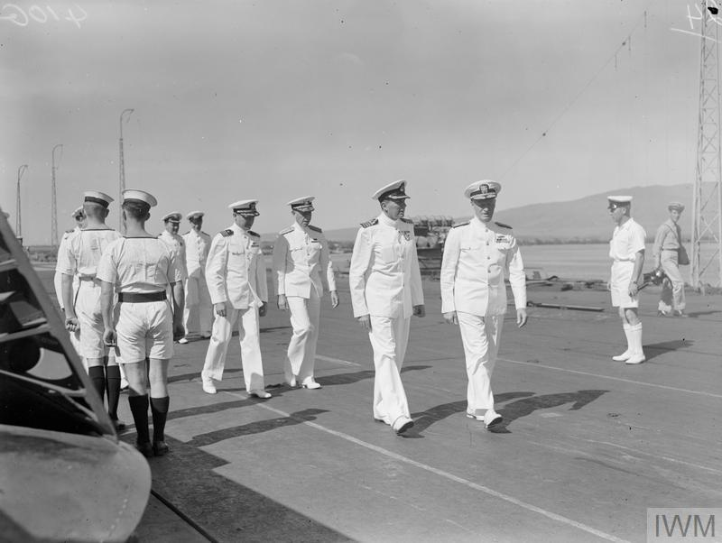 Admiral Nimitz (right) with Captain L D Macintosh, DSO DSC, RN, Commanding Officer of the VICTORIOUS, on the flight deck, 29 April 1943.