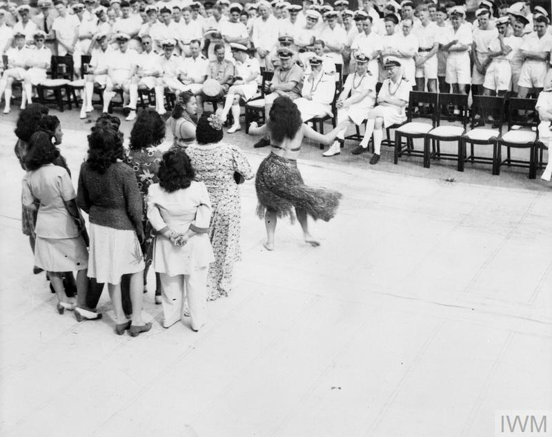 Hula girls dancing on the flight deck of the VICTORIOUS at Honolulu.