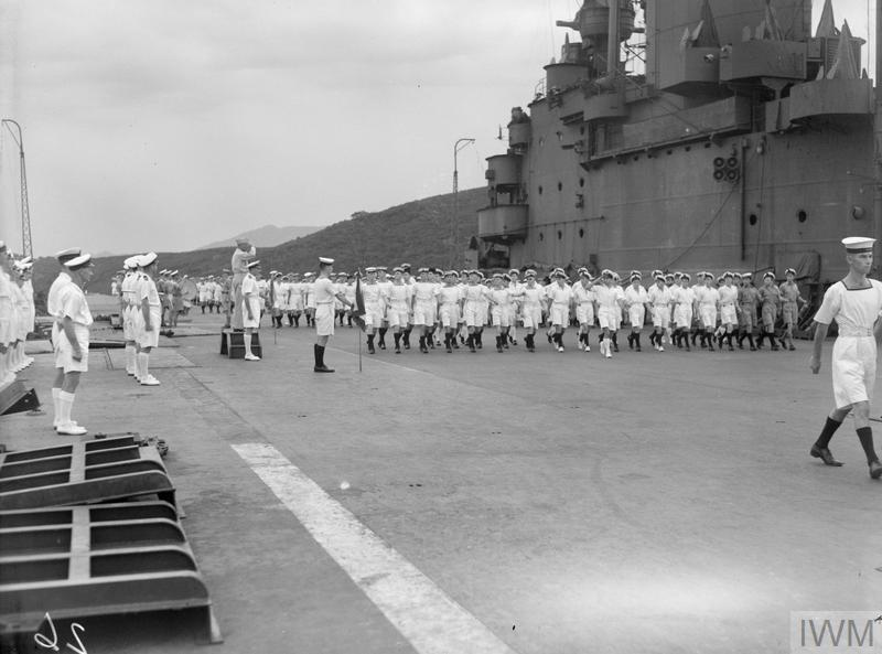 Admiral Ramsey, I/C Task Force, taking the salute as the ship's company of HMS VICTORIOUS march past, March 1943.