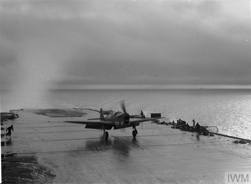 The Firefly, two seater long range fighter landing on the flight deck of HMS ILLUSTRIOUS, February 8-9, 1943, on the Clyde.