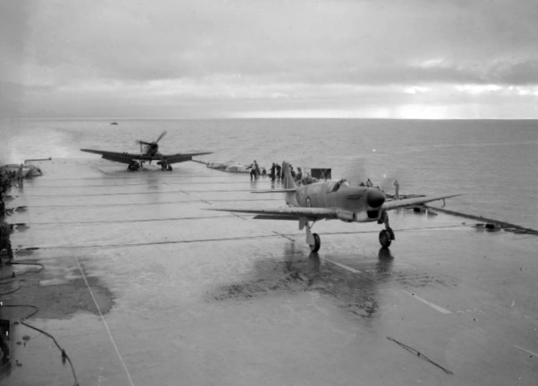 A prototype Fairey Firefly takes off ahead of a prototype Blackburn Firebrand aboard HMS ILLUSTRIOUS.