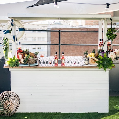 Hamptons Bar   White wooden front and side with a timber bar top 3000mm (L) x 1800mm (W) x 2400mm (H)  2200mm (L) with roof sides lowered $500