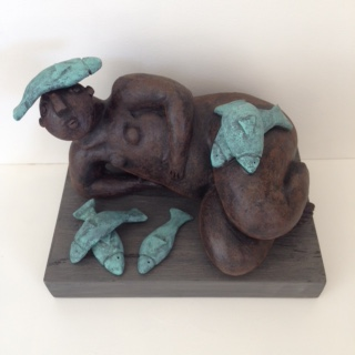 RECLINING FIGURE WITH FISH