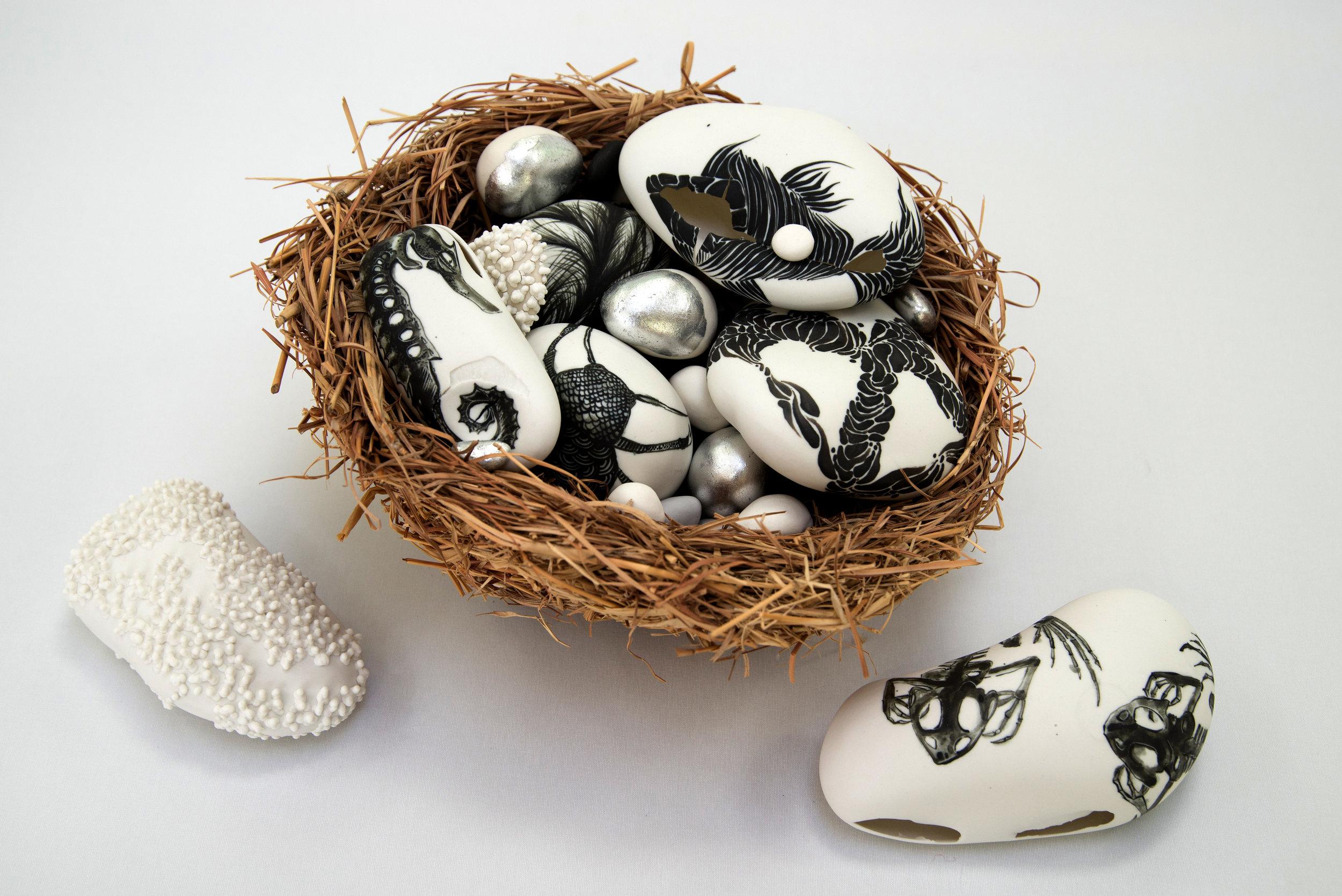 Media: southern ice porcelain, MFQ underglaze stains, silver leaf, handmade rafia nest   Size: 30 cm x 18 cm x 20 cm   Price: $1200