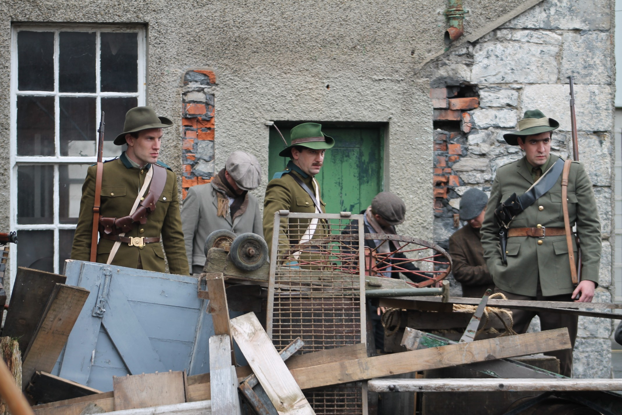 Cmdt. Ned Daly (Owen McDonnell) and the Shouldice brothers (Rick Burn and Colin D. Farrell) man a barricade at North King St.