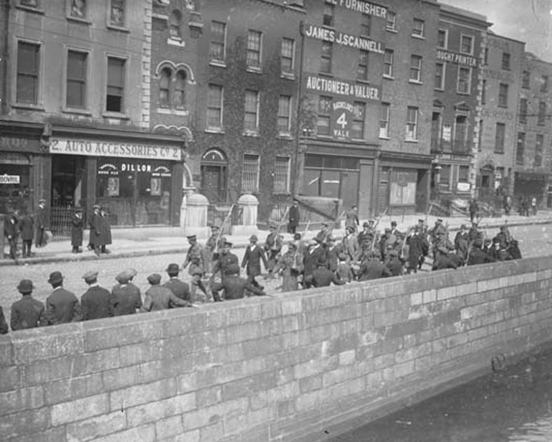 Irish Volunteer being led along the quays by British soldiers after their surrender