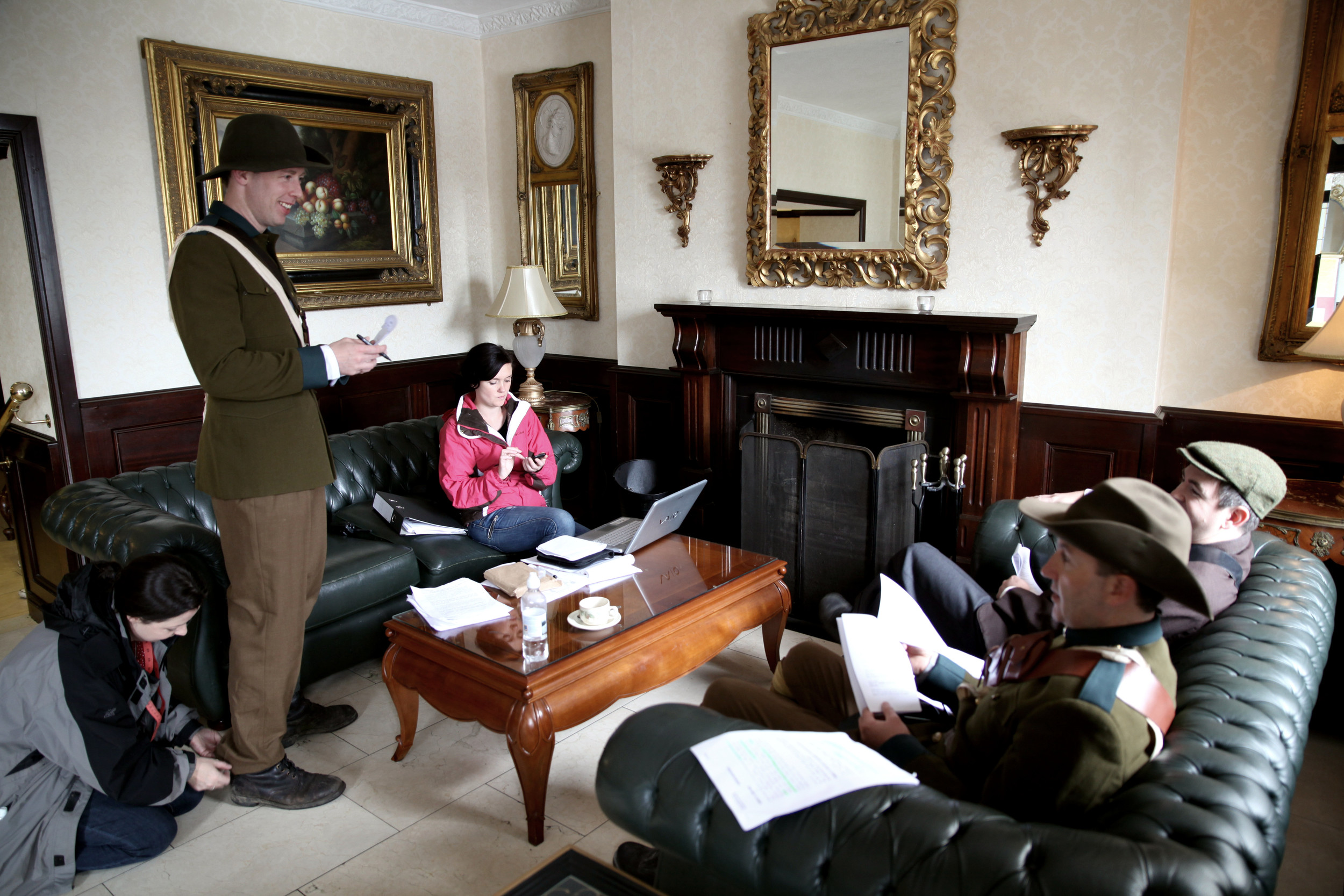 Production Manager Rebecca O'Malley and Irish Volunteers Seamus Hughes, Malachy McKenna and Cillian O'Donnachadha relax and learn their lines during a break in filming.