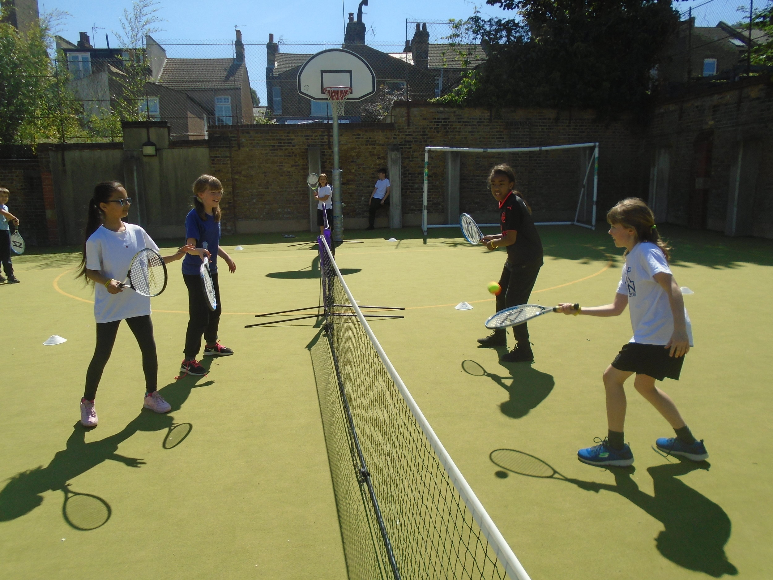 P.E. - Over this term, Mr Dennis has been busy teaching Year Five the skills of tennis. You never know, we might see them at Wimbledon, in the future!