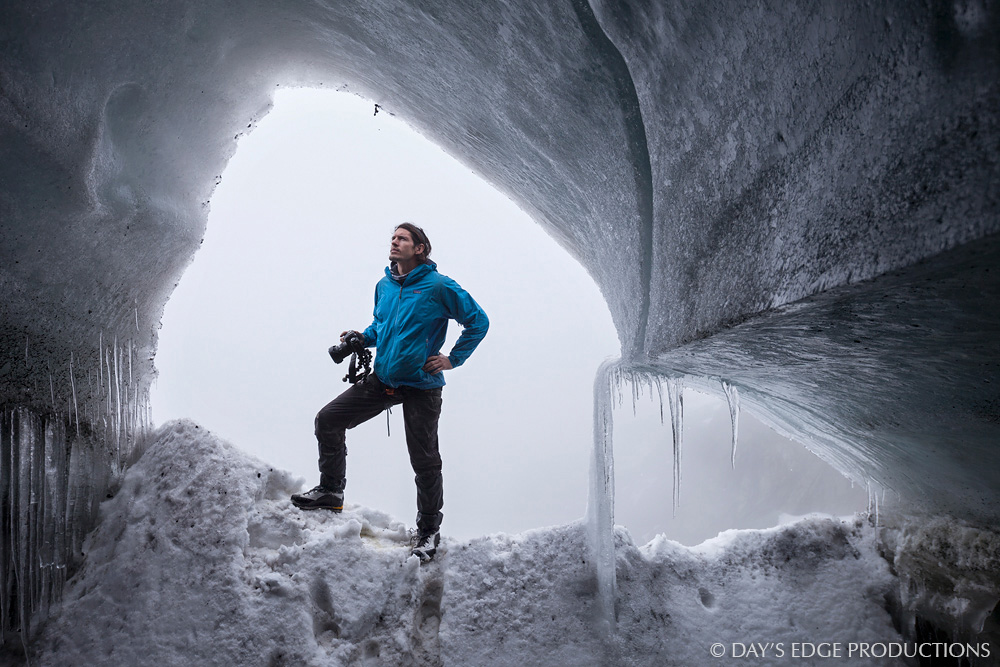 Biologist and photographer Nate Dappen at the mouth of an ice cave in the Margherita Glacier on Mount Stanley, Rwenzori Mountains National Park, Uganda.