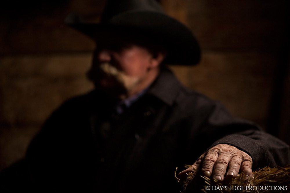 Bruce Switzer, a 4th-generation cattle rancher, rests in his barn in the Nebraska sandhills.