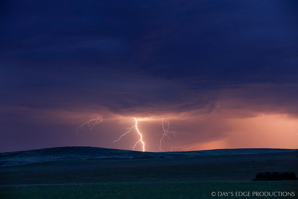 A massive lightning bolt strikes the open plains during an autumn thunderstorm in the Pine Ridge Indian Reservation, South Dakota.